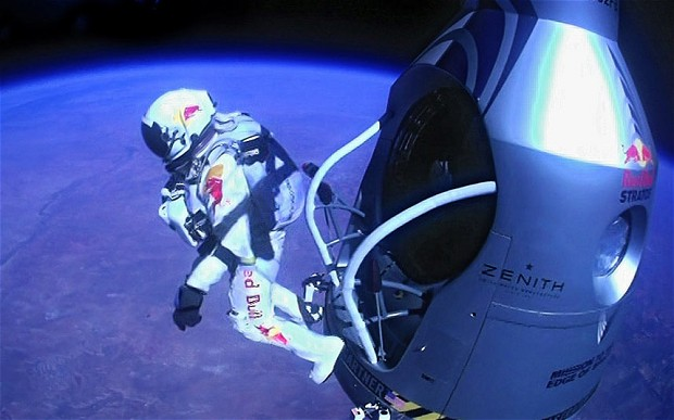 Felix Baumgartner of Austria as he jumps out of the capsule during the final manned flight for Red Bull Stratos - Red Bull Stratos/AP